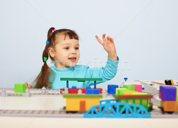 Child plays with a toy railroad Stock photo © pzaxe