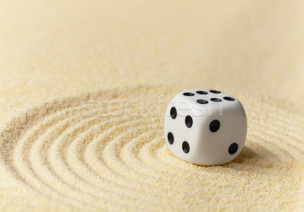Playing white dice on yellow sand - art miniature Stock photo © pzaxe