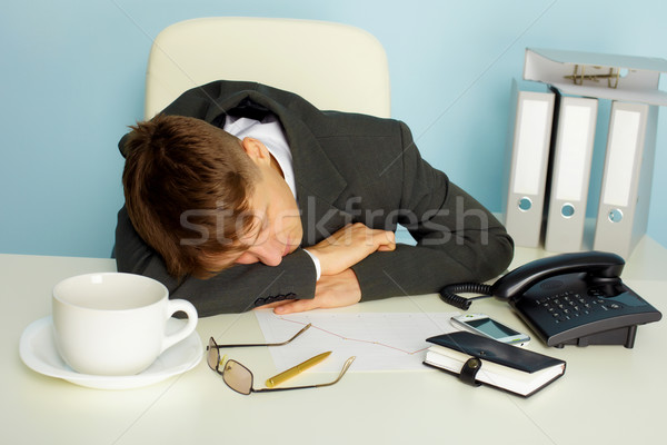 Tired man sleeping on a table Stock photo © pzaxe
