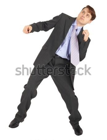 Jeune homme faire sauter isolé blanche affaires costume Photo stock © pzaxe