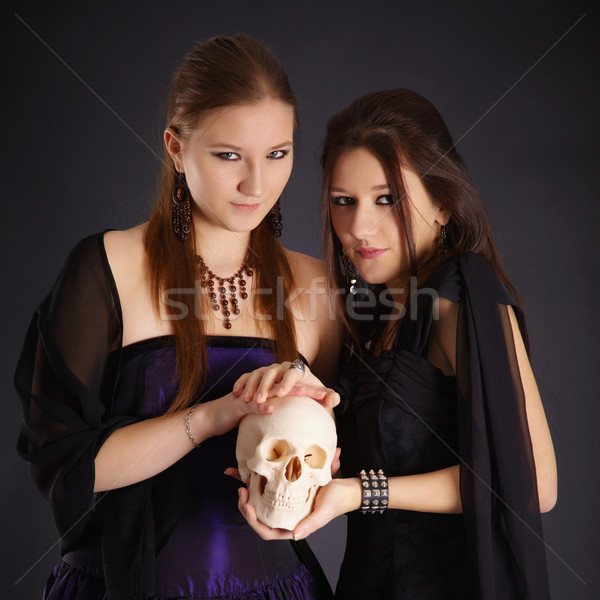 Two young girls with a human skull Stock photo © pzaxe