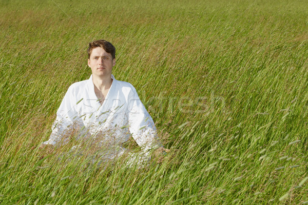Man sits in grass Stock photo © pzaxe