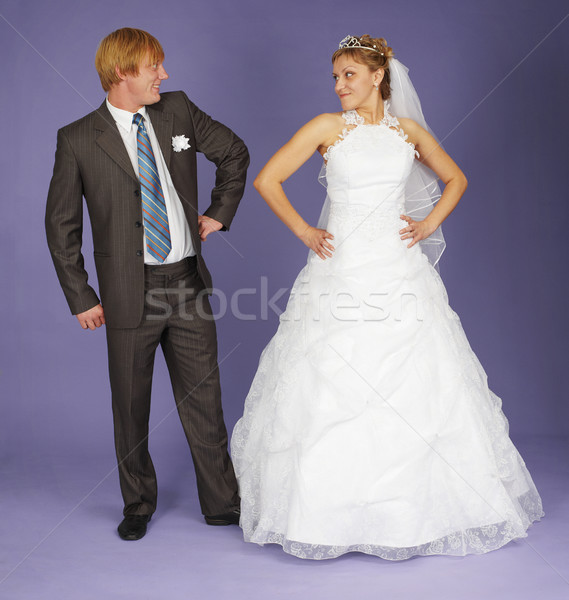 Funny Newlyweds standing on blue Stock photo © pzaxe