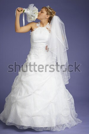 Beautiful bride poses on violet background Stock photo © pzaxe
