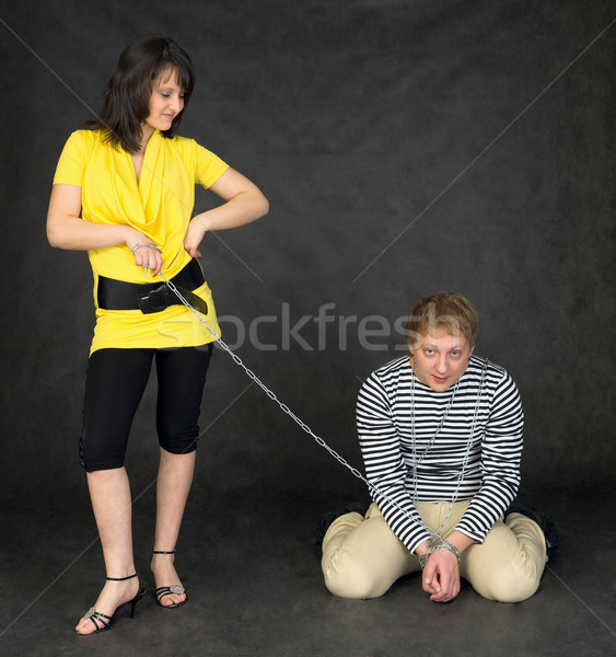 Guy chained in a chain and girl Stock photo © pzaxe
