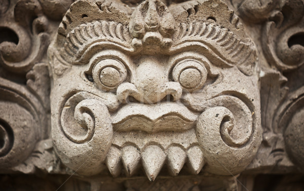 Stock photo: Face of the ancient deities carved in stone. Indonesia, Bali