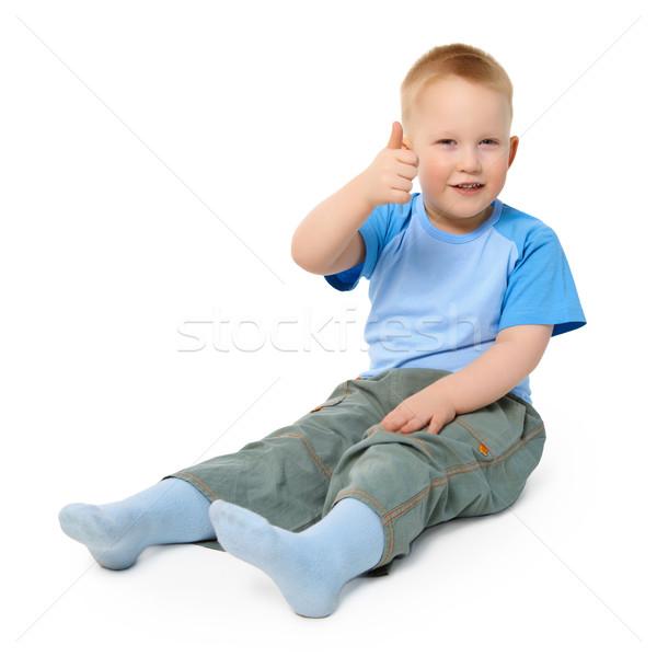 Pequeno menino branco gesto polegar Foto stock © pzaxe