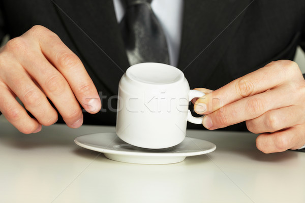 Businessman guesses on coffee grounds Stock photo © pzaxe