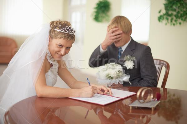 Marriage registration. Bride is happy. Groom in grief. Stock photo © pzaxe
