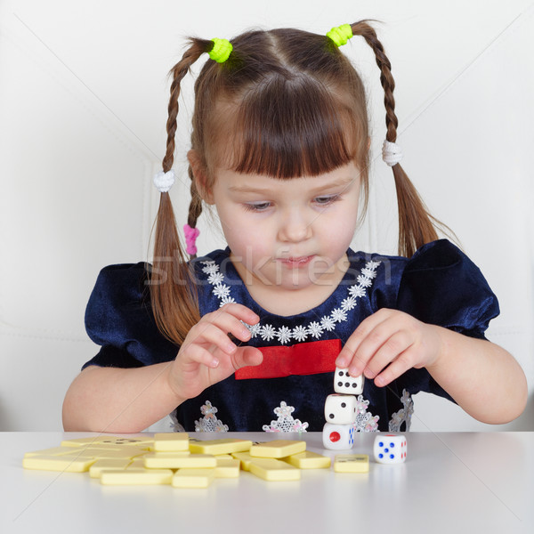Child playing with small toys at table Stock photo © pzaxe