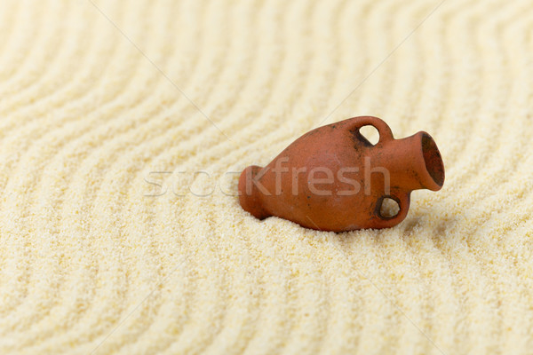 Ancient clay amphora on surface of yellow sand Stock photo © pzaxe