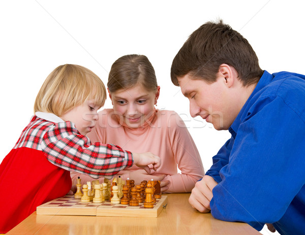 Man and child play chess Stock photo © pzaxe