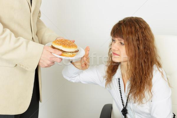 молодые красивая девушка вредный продовольствие женщину служба Сток-фото © pzaxe