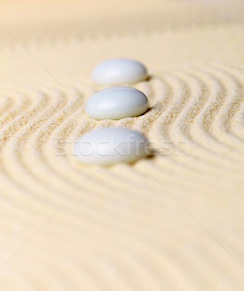 Composition three white stones on yellow sand - Zen Garden Stock photo © pzaxe
