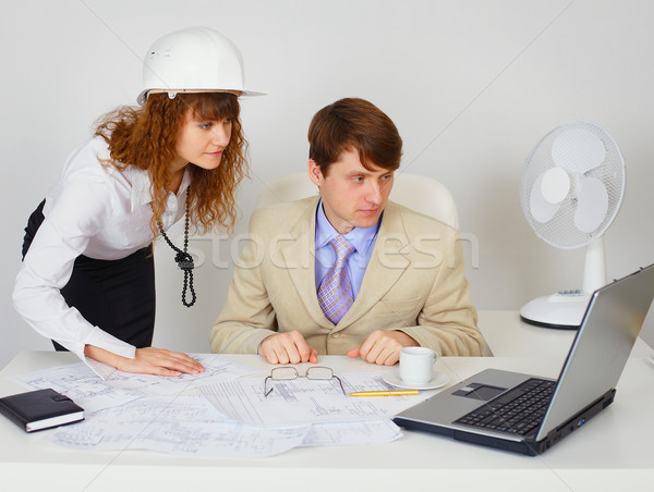 Business construction industry team looking on laptop Stock photo © pzaxe