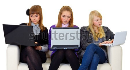 Young girls read fiction on couch Stock photo © pzaxe