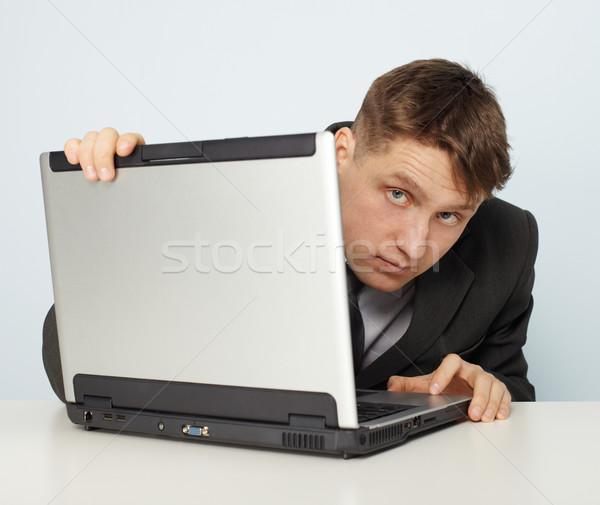 Ilegal hombre negocios traje ordenador Foto stock © pzaxe