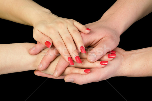 Man's and female hands on a black Stock photo © pzaxe