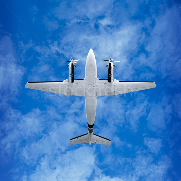 Bottom view - twin prop airplane on sky background Stock photo © pzaxe