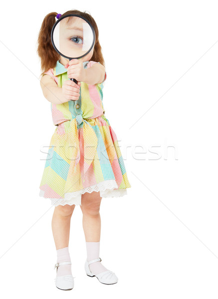 Comical child with magnifying glass in hands Stock photo © pzaxe