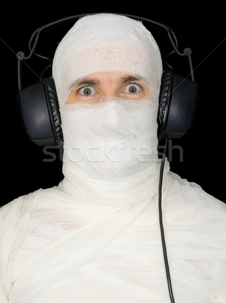 Man in bandage with ear-phones  Stock photo © pzaxe