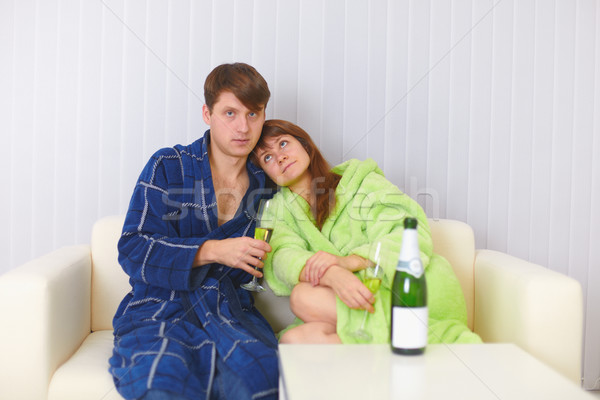 Husband and wife sit on sofa and drink fizz Stock photo © pzaxe