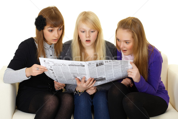 Three young girls reading newspaper Stock photo © pzaxe