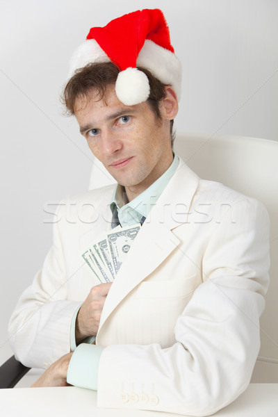 Person hides Christmas prize in pocket Stock photo © pzaxe