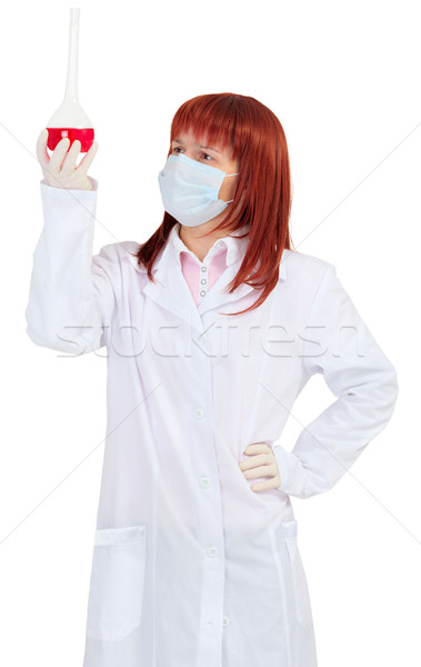 Woman - scientist analyzes color of solution in flask Stock photo © pzaxe