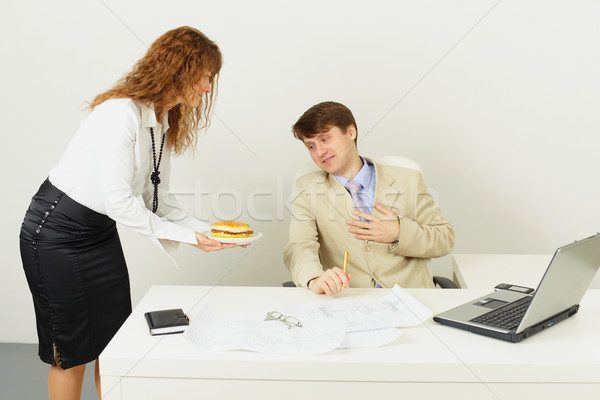 Young woman delivered to chief a sandwich to dinner Stock photo © pzaxe