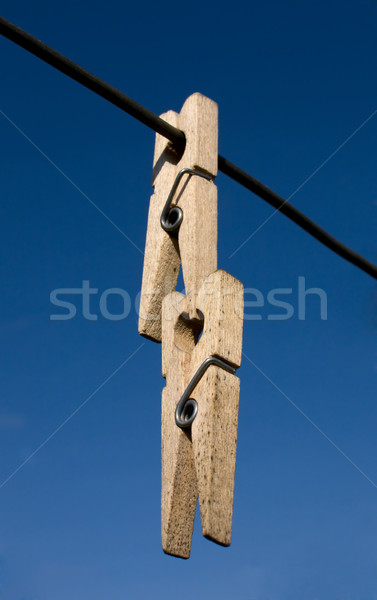 Stock photo: Two wooden clothes-peg