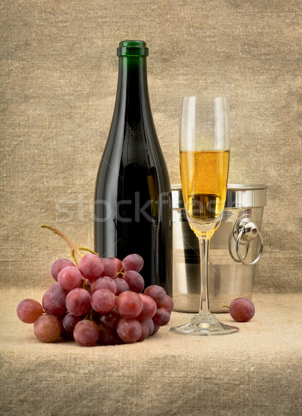 Champagine bottle, grape and goblet on canvas background Stock photo © pzaxe