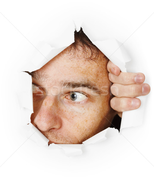 Man looks through hole Stock photo © pzaxe