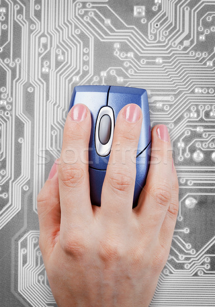 Hand and computer mouse on electronic background Stock photo © pzaxe