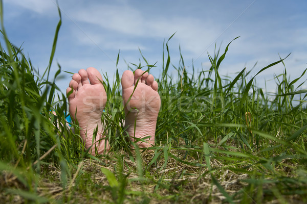 Barefooted foot in grass Stock photo © pzaxe