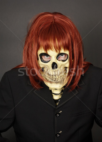 Masked man - skeleton in red wig Stock photo © pzaxe