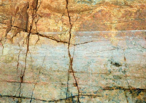 Cracked rock on seacoast backdrop Stock photo © pzaxe