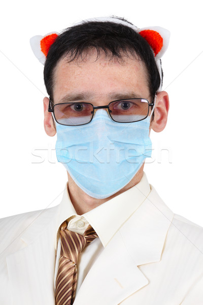 Man in a medical mask and with pig ears Stock photo © pzaxe