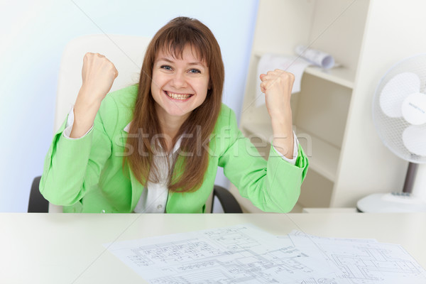 Emotional girl rejoices sitting in an armchair Stock photo © pzaxe
