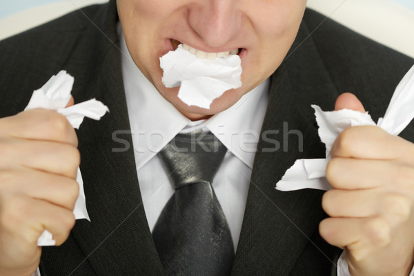Businessman furiously tearing paper Stock photo © pzaxe