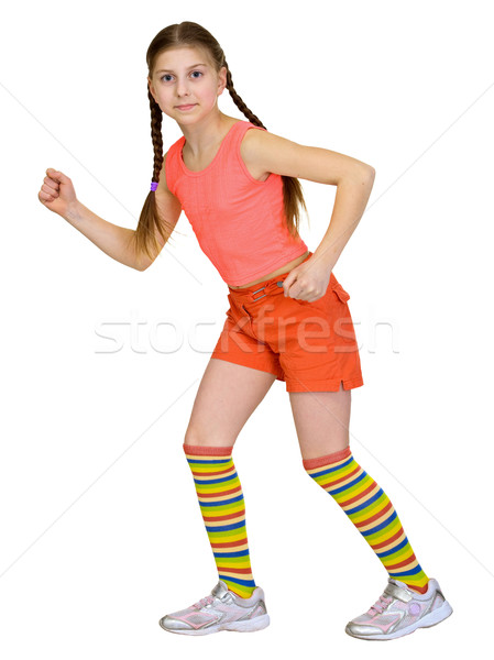 Stock photo: Running girl in a T-shirt on a white