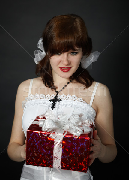 Beautiful girl rejoices to surprising gift Stock photo © pzaxe
