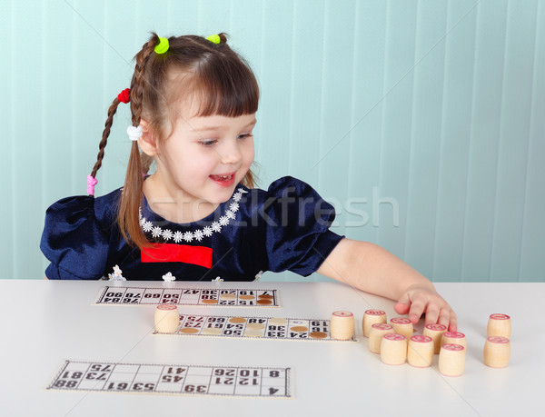 Child playing with bingo at the table Stock photo © pzaxe