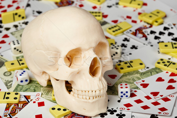 Skull on playing cards and money Stock photo © pzaxe
