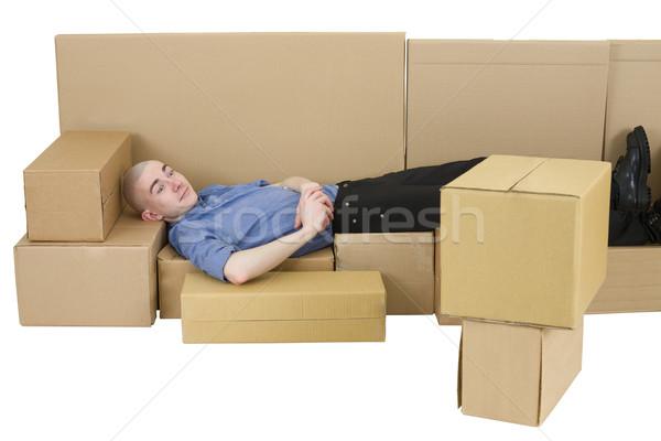 Man with carton TVset and sofa Stock photo © pzaxe