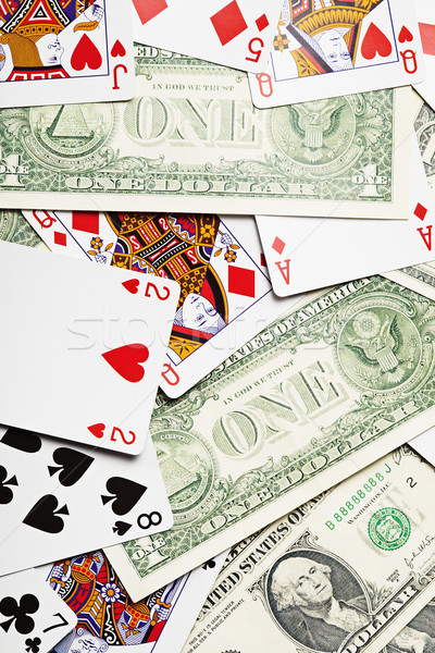 Background of playing cards and money Stock photo © pzaxe