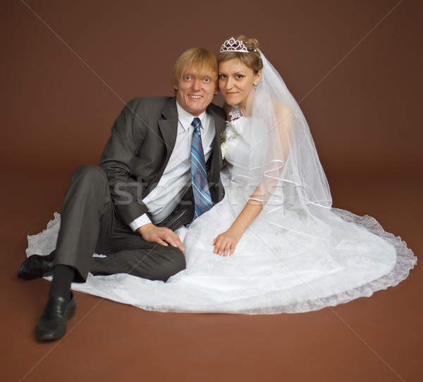 Happy newly-married couple on brown background Stock photo © pzaxe