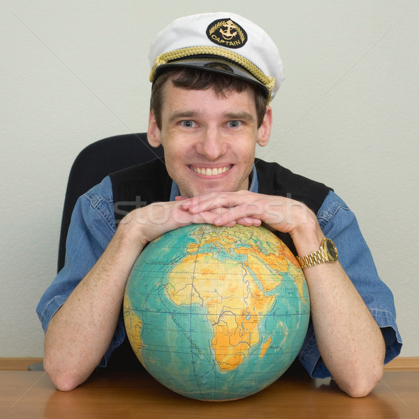 Young smiling guy in cap Stock photo © pzaxe