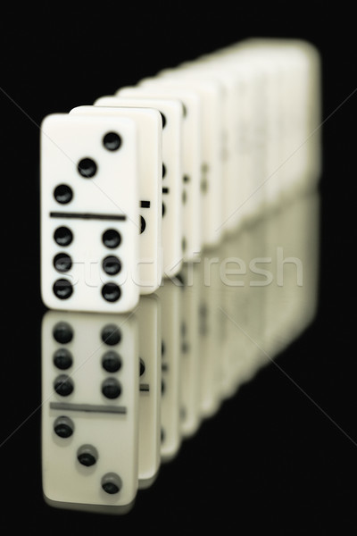 Bones of dominoes on a black background Stock photo © pzaxe