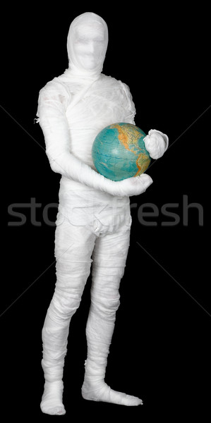 Man in costume mummy and terrestrial globe Stock photo © pzaxe